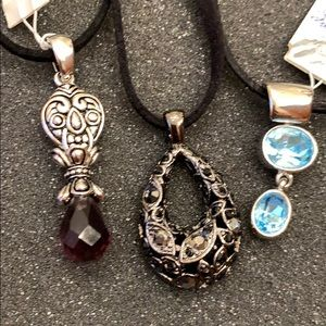 3 Pendants with black lanyards